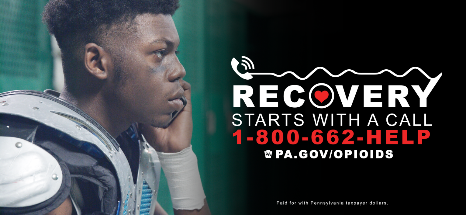 Get Help Now billboard with football player